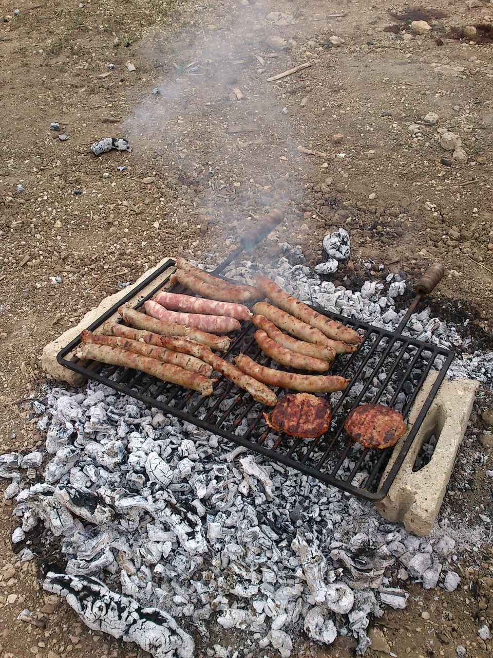 High Angle View Of Sausages On Barbeque