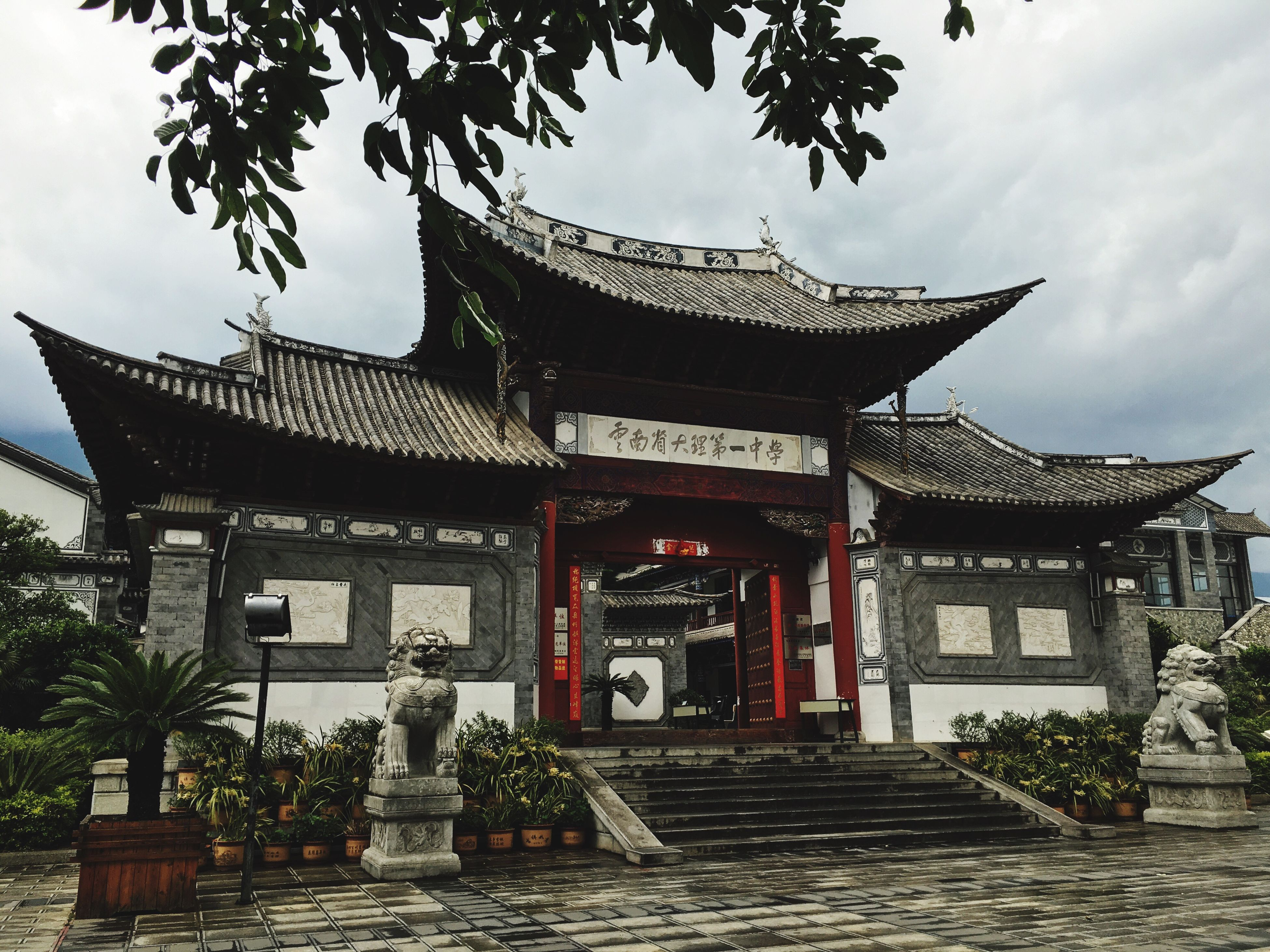 architecture, building exterior, built structure, place of worship, religion, spirituality, temple - building, temple, tree, tradition, low angle view, sky, roof, ornate, pagoda, facade, entrance, cultures, travel destinations