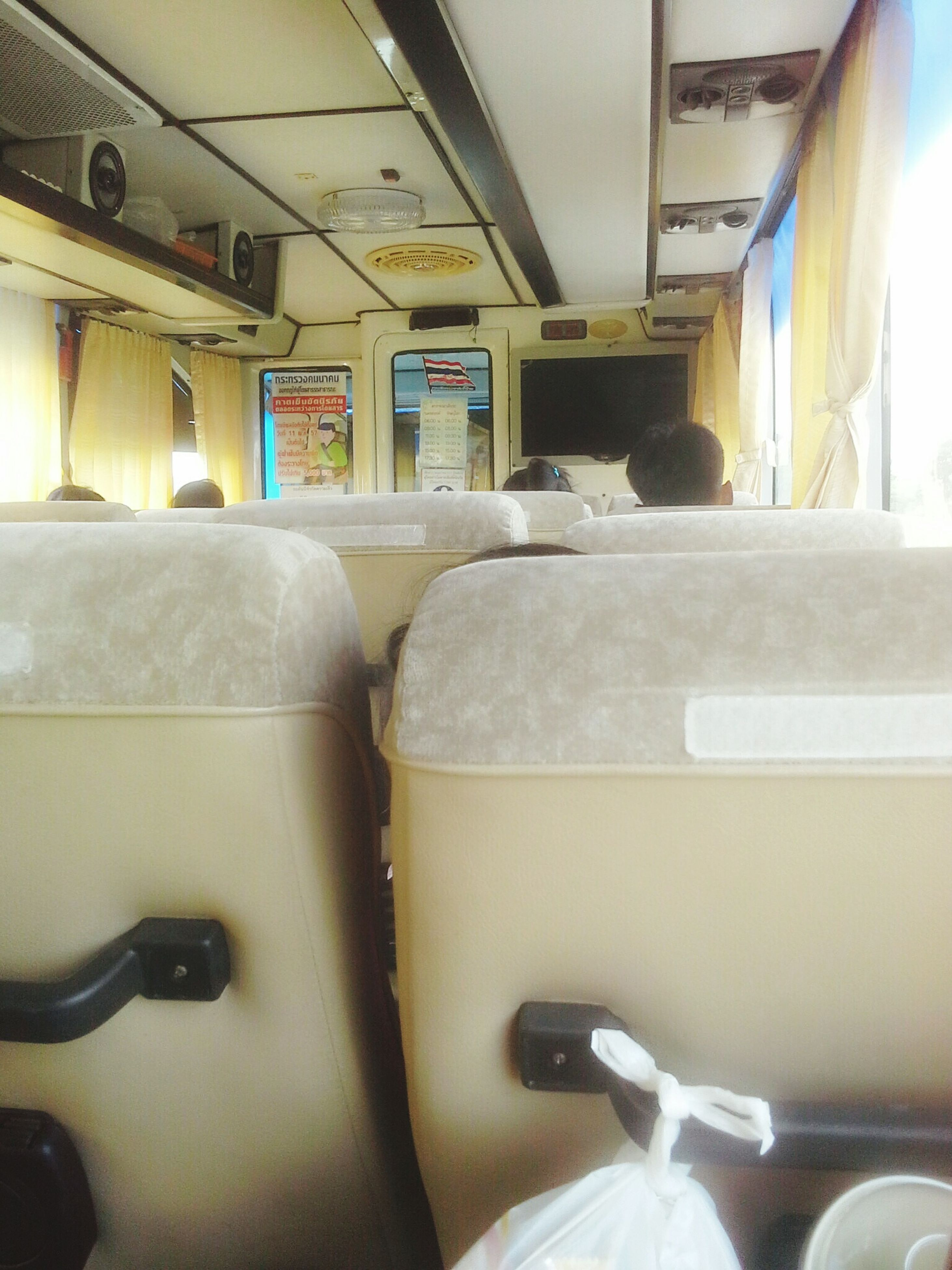 indoors, transportation, mode of transport, vehicle interior, vehicle seat, window, land vehicle, public transportation, interior, no people, absence, day, travel, empty, in a row, reflection, seat, train - vehicle, glass - material, car