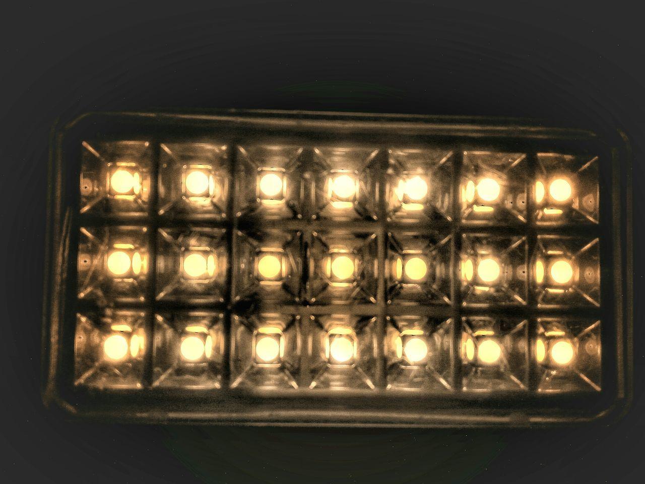 illuminated, lighting equipment, shape, no people, indoors, pattern, electricity, night, close-up, black background, spotlight