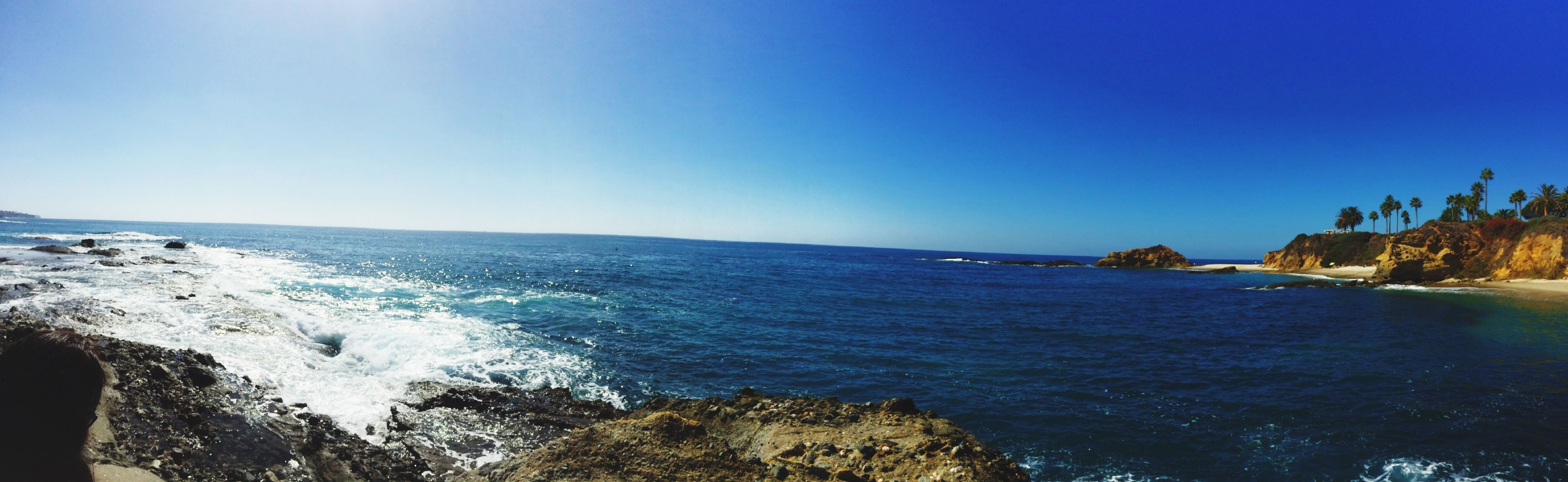sea, water, blue, clear sky, horizon over water, scenics, copy space, tranquil scene, beauty in nature, tranquility, nature, beach, idyllic, coastline, shore, day, sky, wave, outdoors, sunlight