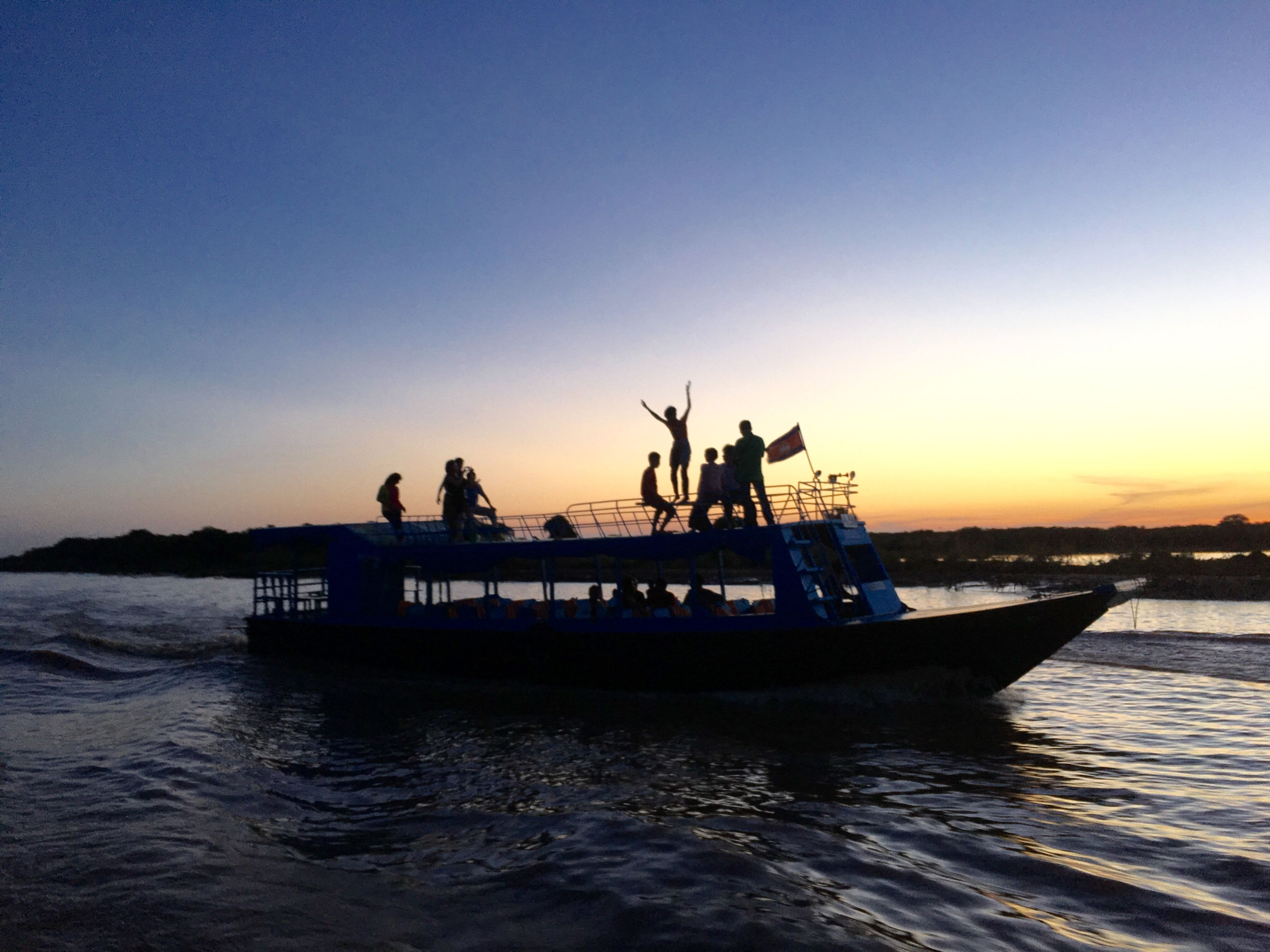 water, silhouette, sunset, transportation, sea, nautical vessel, waterfront, mode of transport, boat, clear sky, copy space, men, nature, sky, scenics, beauty in nature, tranquility, tranquil scene, rippled