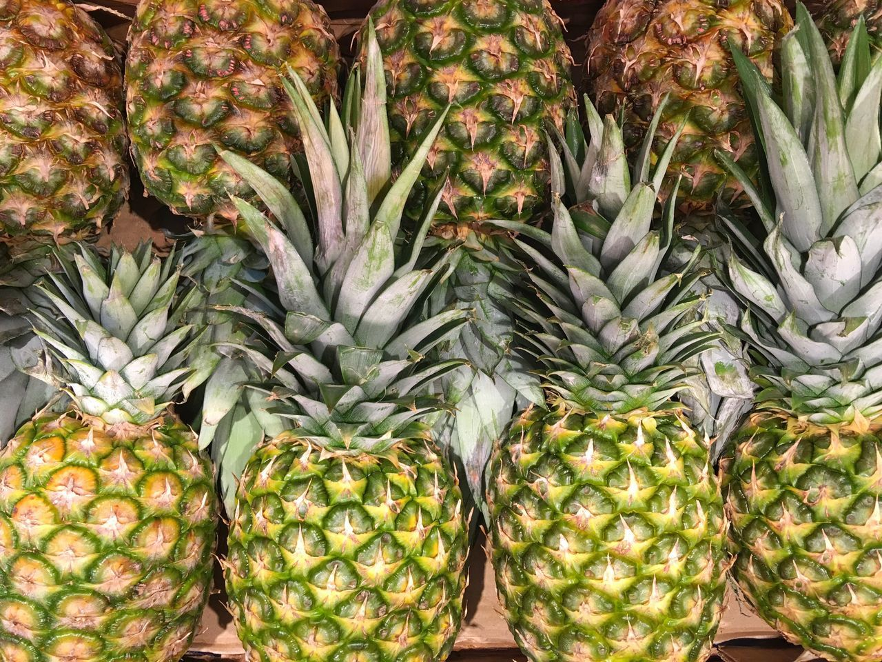 Pineapples Freshness Food And Drink Market Food For Sale Healthy Eating Market Stall Retail  Exotic Fruits Consumerism High Angle View Business Close-up Abundance Choice Retail Display Organic Healthy Lifestyle Sale Selective Focus Beautifully Organized