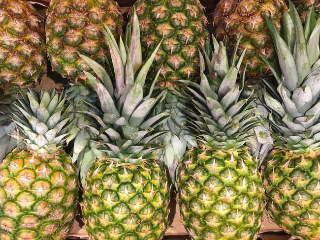 Pineapples Freshness Food And Drink Market Food For Sale Healthy Eating Market Stall Retail  Exotic Fruits Consumerism High Angle View Business Close-up Abundance Choice Retail Display Organic Healthy Lifestyle Sale Selective Focus