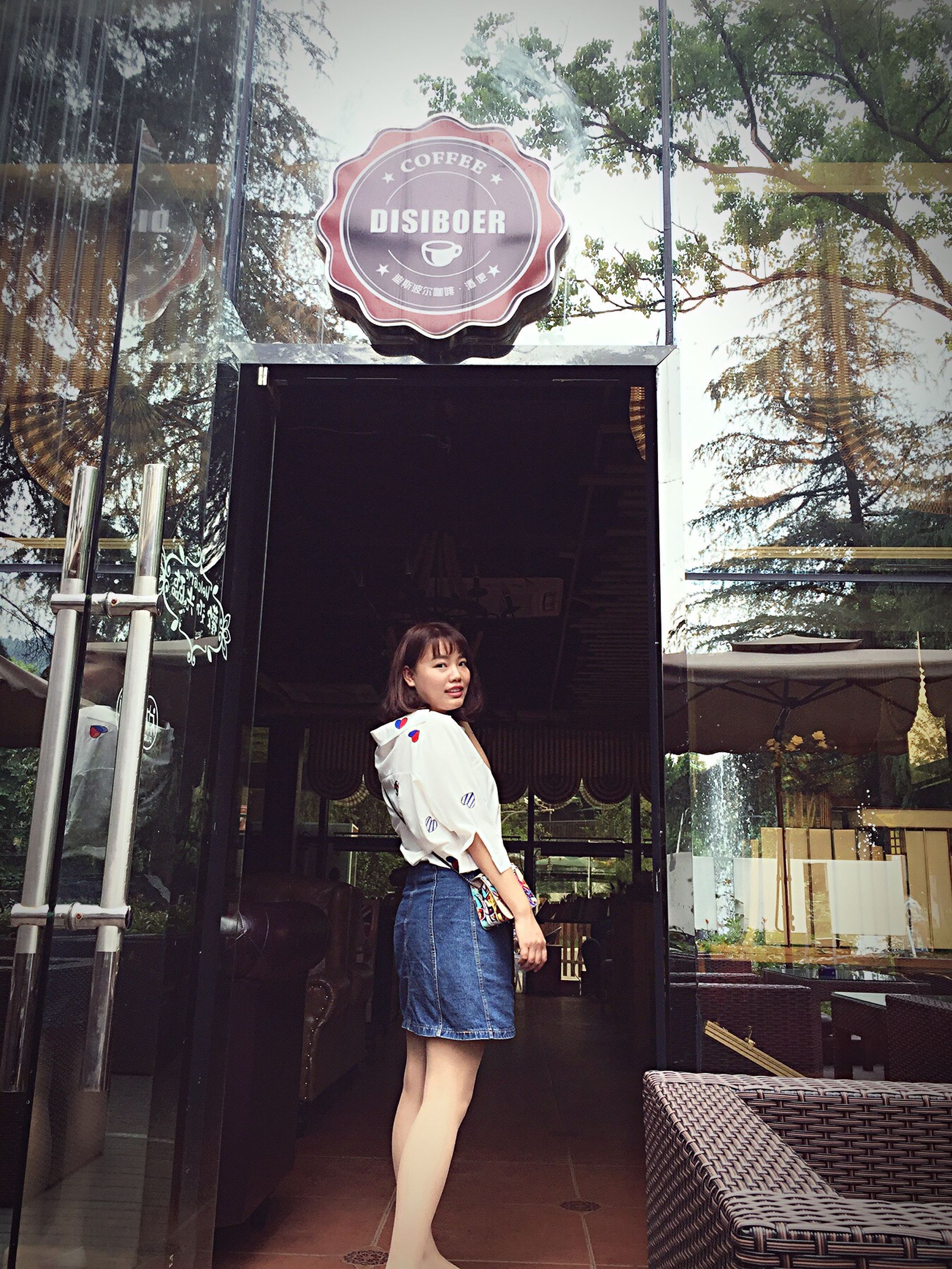 lifestyles, person, young adult, casual clothing, building exterior, architecture, built structure, full length, standing, leisure activity, front view, young women, looking at camera, portrait, three quarter length, smiling, happiness