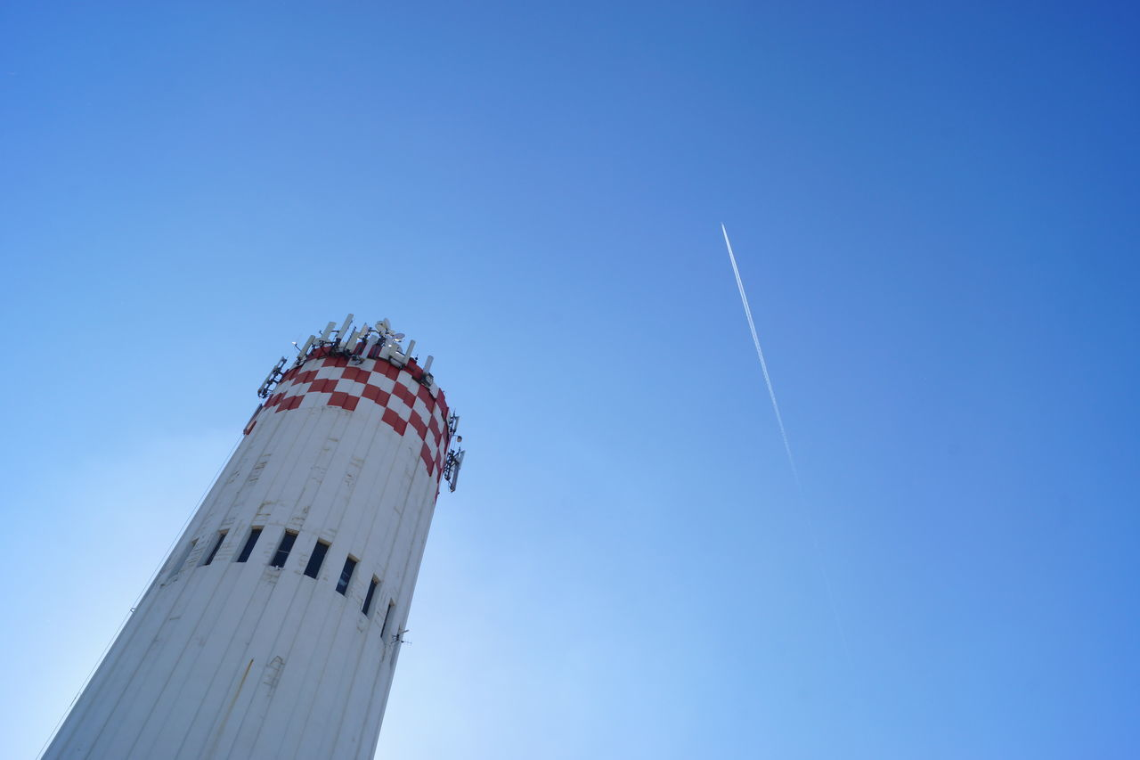 Arts Culture And Entertainment Low Angle View Motion Sky Day Flying Outdoors Clear Sky No People Vapor Trail Outdoors Photograpghy  EyeEm Gallery EyeEmBestPics Sunlight And Shadows No Filter, No Edit, Just Photography Water Tower Top Communications Technology