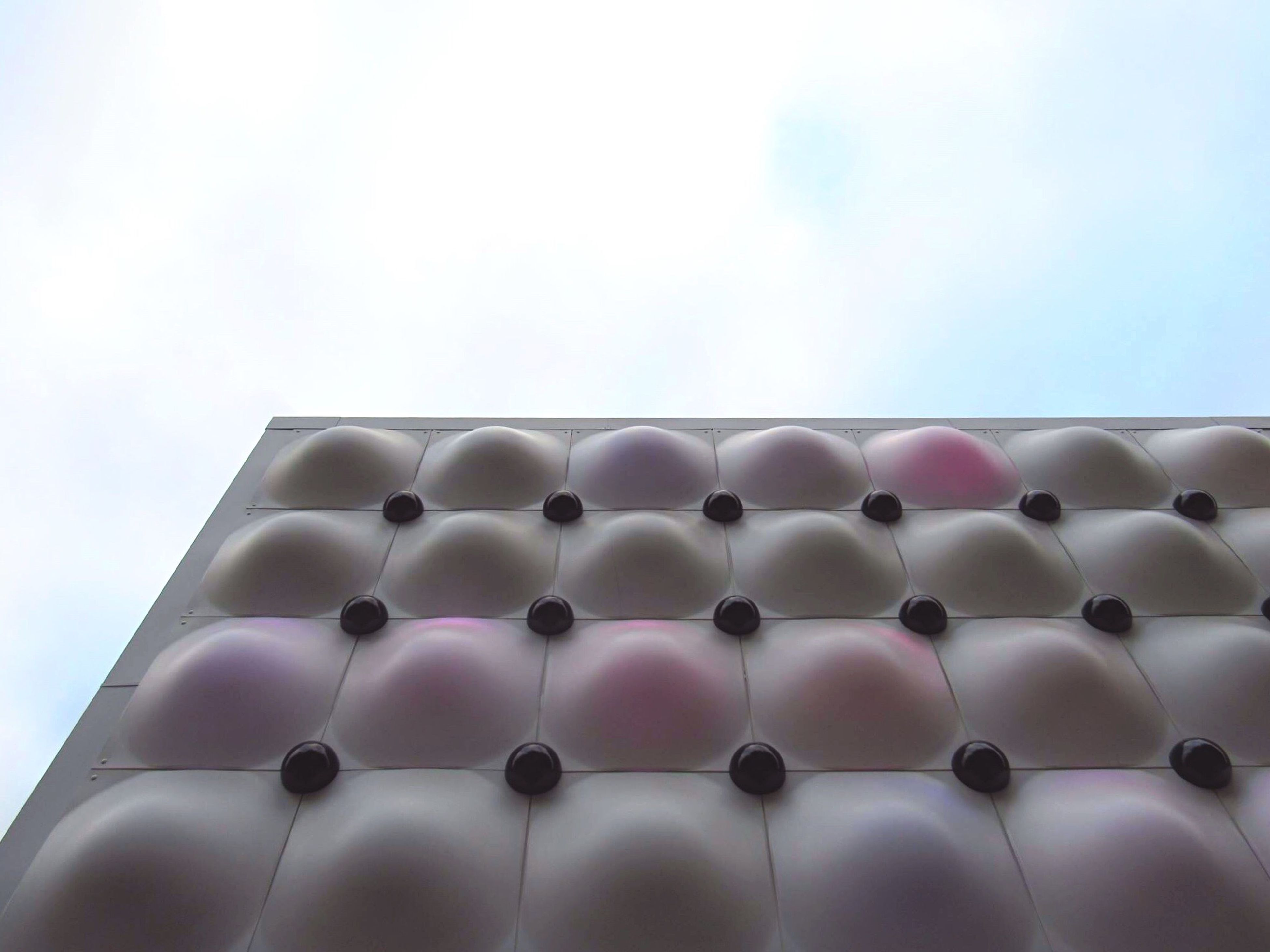 low angle view, in a row, sky, architecture, multi colored, built structure, repetition, copy space, pattern, no people, side by side, order, clear sky, building exterior, blue, shape, day, large group of objects, outdoors, decoration