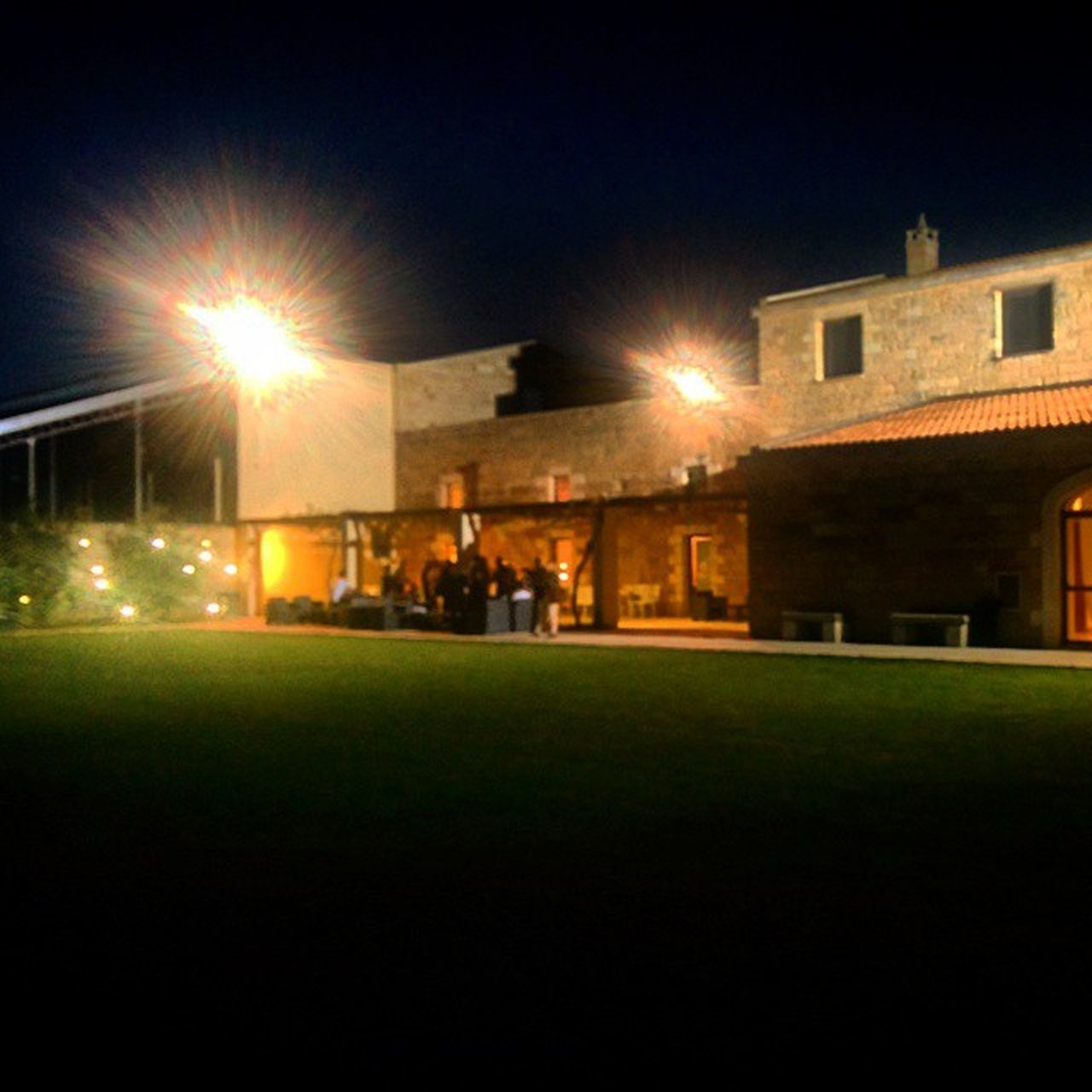illuminated, building exterior, architecture, built structure, night, grass, outdoors, street light, city, no people, soccer field, sky
