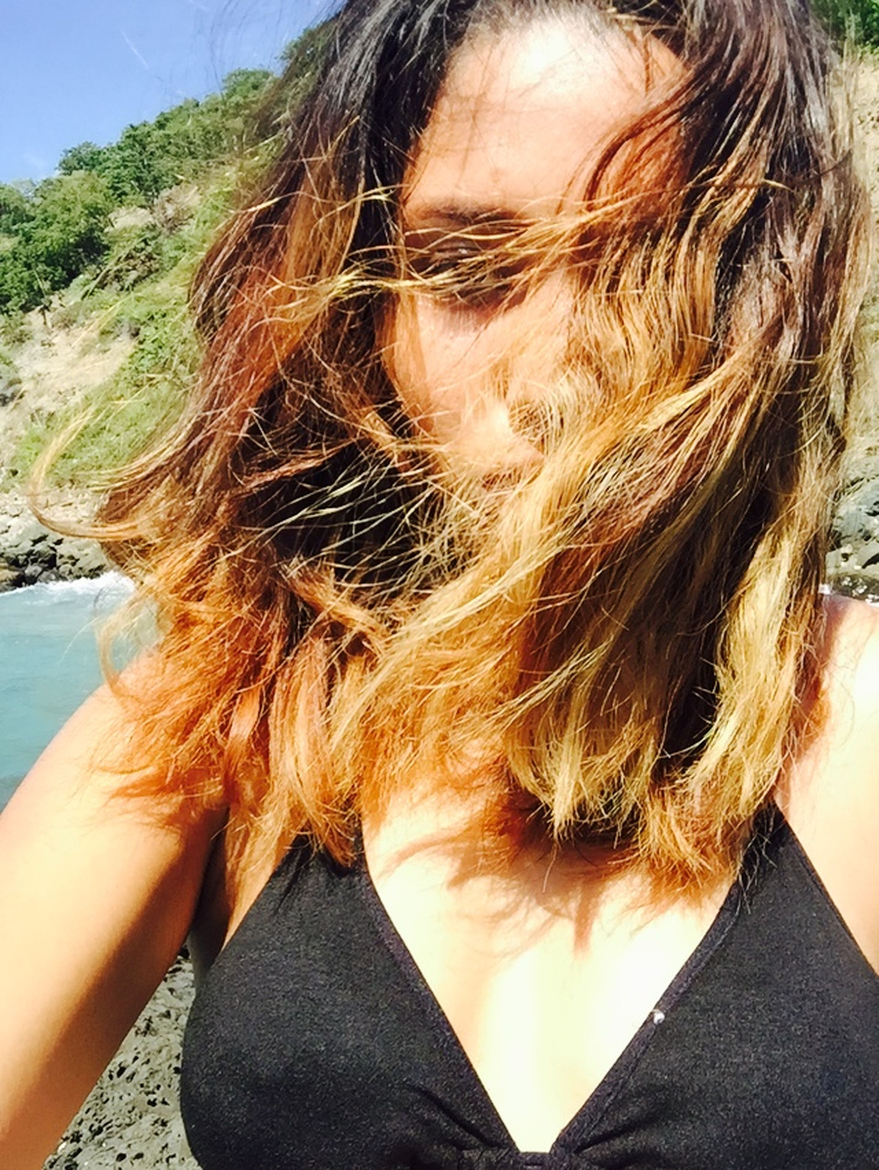 lifestyles, young adult, headshot, long hair, young women, leisure activity, sunlight, person, close-up, day, brown hair, sky, outdoors, head and shoulders, vacations, blond hair