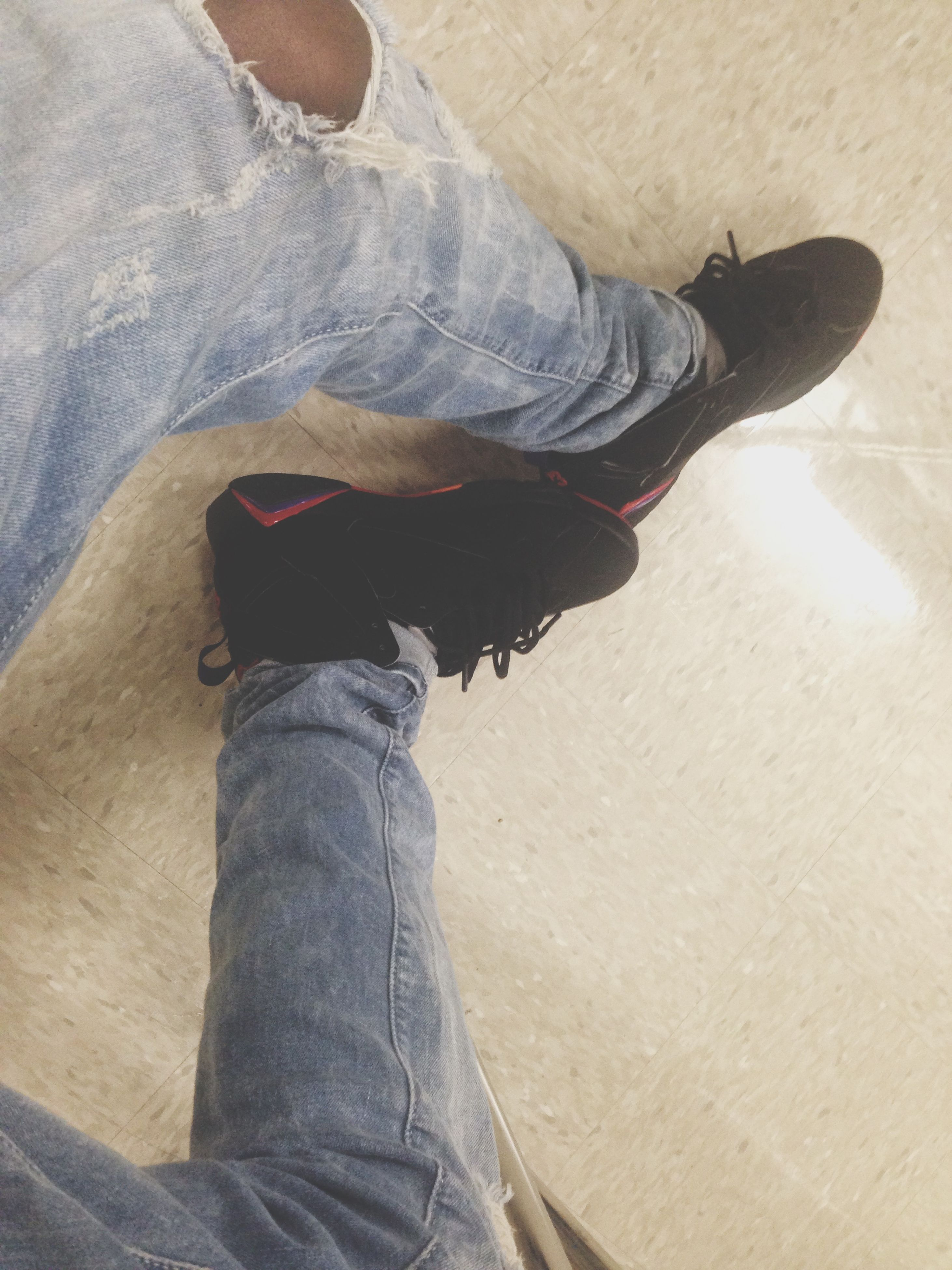 low section, person, shoe, jeans, lifestyles, standing, casual clothing, men, indoors, human foot, leisure activity, personal perspective, high angle view, footwear, sitting, denim