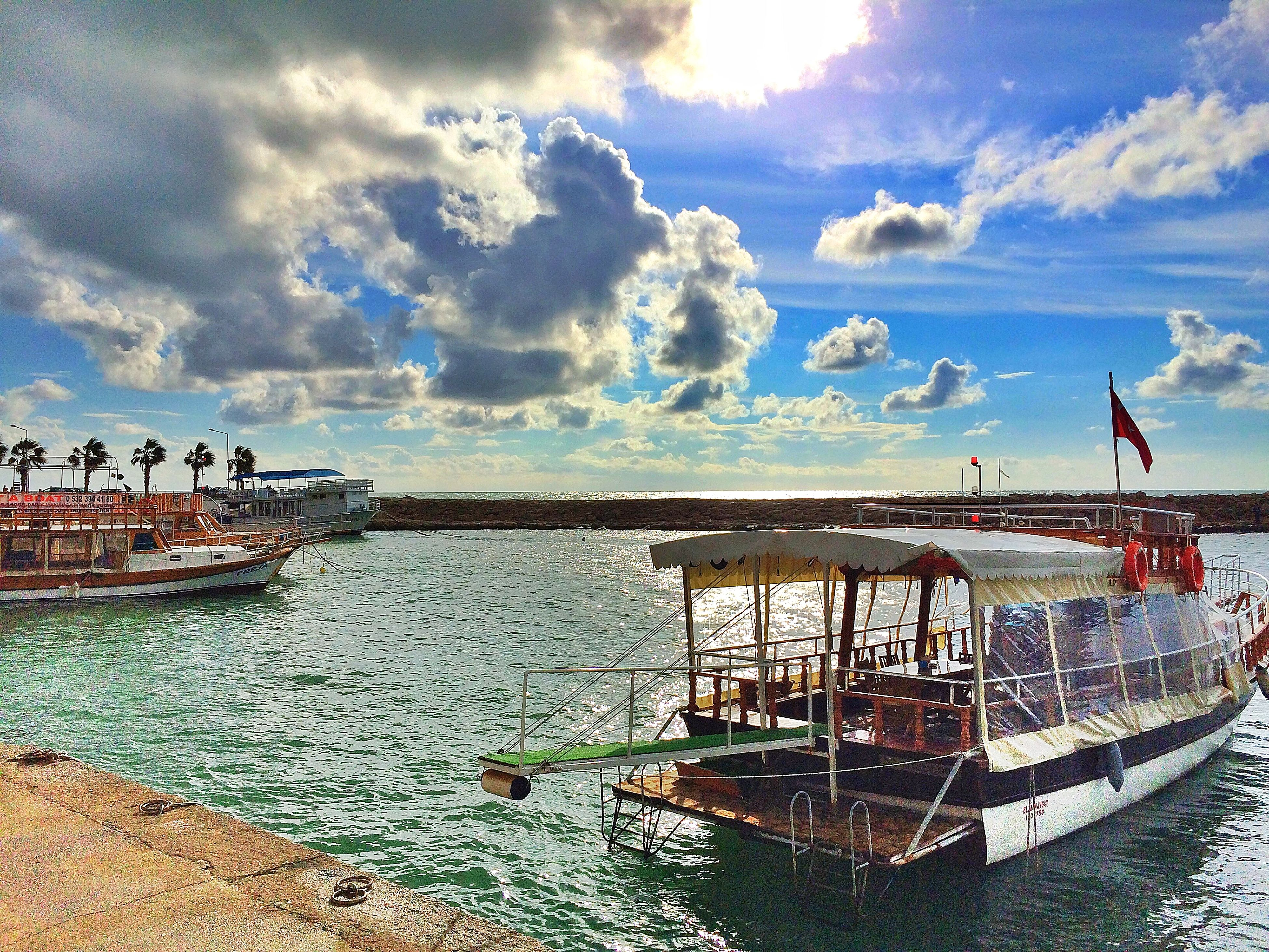 water, sky, sea, cloud - sky, pier, scenics, cloud, cloudy, horizon over water, tranquility, nature, tranquil scene, incidental people, beauty in nature, leisure activity, nautical vessel, railing, rippled, outdoors
