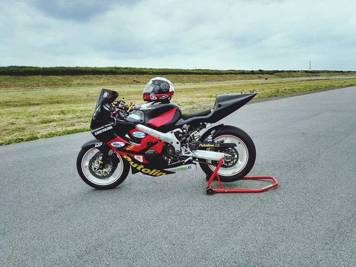 Motorcycle Headwear Riding Crash Helmet Transportation One Person Sports Race Leisure Activity Adventure Day Helmet People Motorsport Competition Sports Track Biker Outdoors Driving Cloud - Sky Sports Clothing First Eyeem Photo Extreme Sports Sitting Adult Motorcycle Racing