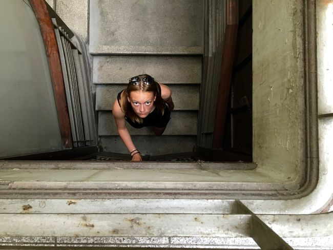 should I stay or should I go? Big Eyes From Above  The Week On EyeEm Basement Into The Darkness Into The Unknown One Person Portrait Portrait Photography Real People Should I Stay Or Should I Go? Spooky Staircase Steps Young Adult Young Women