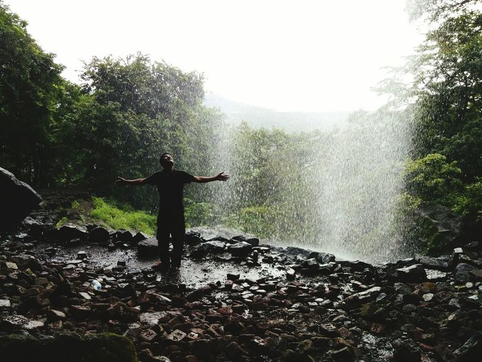 Waterfall Tree Shower Alone Prayer SURRENDER Surrendering To Rain Rain Mountain Cliff Day Silhouette Beauty In Nature No People Sky