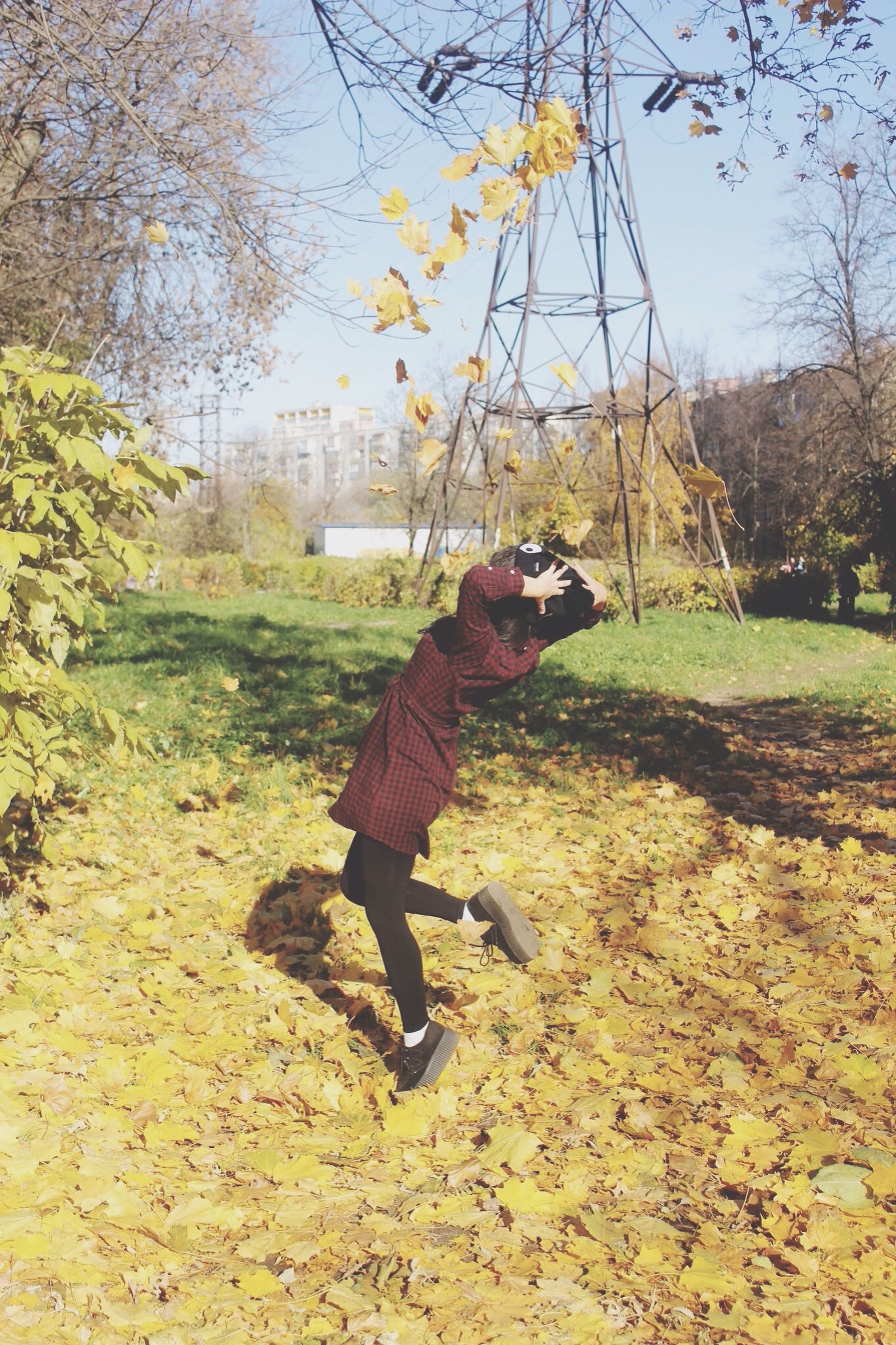 lifestyles, water, full length, autumn, leisure activity, tree, reflection, day, umbrella, standing, change, men, nature, outdoors, walking, season, built structure, grass