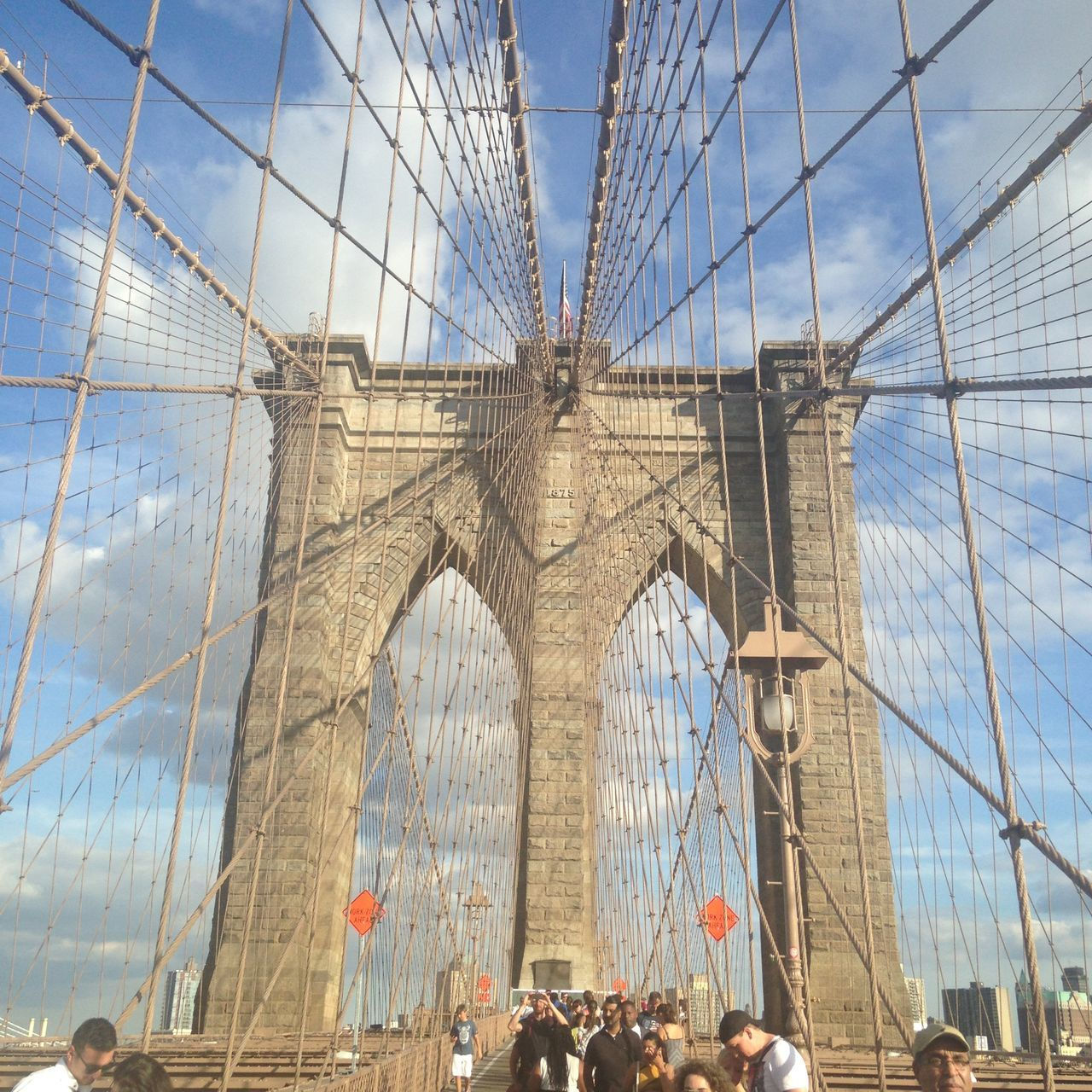 architecture, built structure, tourism, large group of people, travel destinations, travel, arch, sky, bridge - man made structure, day, women, real people, outdoors, suspension bridge, vacations, men, building exterior, city, crowd, people, adult