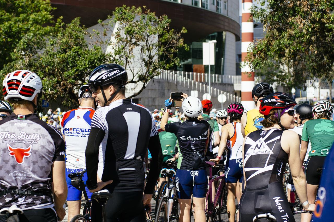real people, outdoors, men, day, large group of people, headwear, helmet, tree