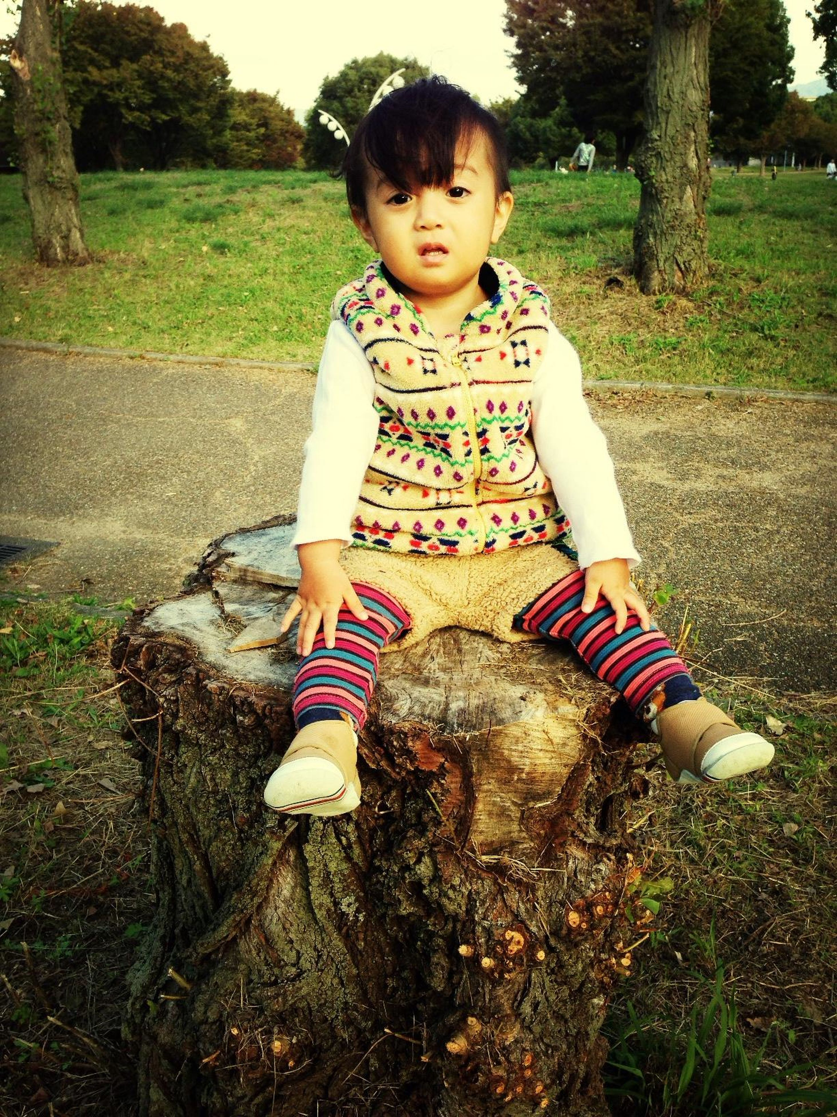 person, childhood, casual clothing, lifestyles, leisure activity, elementary age, full length, front view, looking at camera, girls, happiness, portrait, grass, smiling, standing, cute, innocence, tree