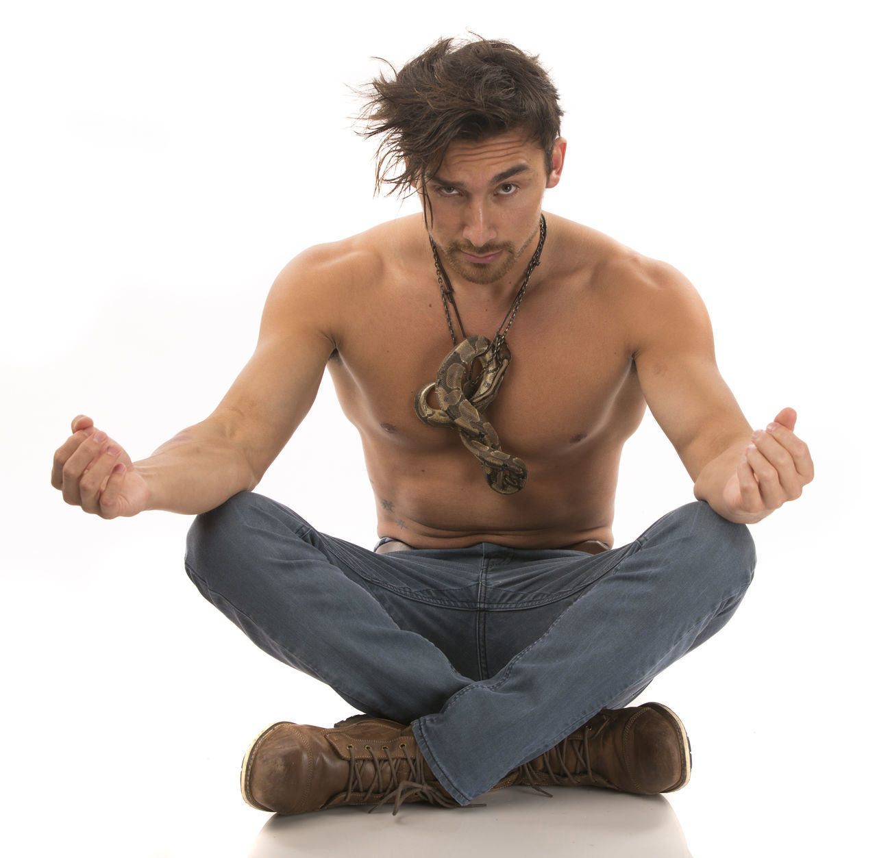 Shirtless Male squatting with snake Cross-legged Cut Out Day Exercising Front View Full Length Indoors  Lifestyles Looking At Camera Men Muscular Build One Person Pet Portrait Real People Reptile Shirtless Sitting Snake Squat Studio Shot White Background Yoga Young Adult Young Men