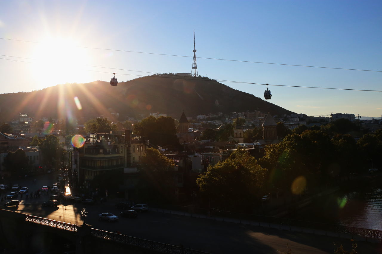 Architecture Building Exterior Built Structure Business Finance And Industry City Cityscape Drone  Georgia Horizontal Mountain Nature No People Outdoors Silhouette Sky Sun Sunbeam Tbilisi Tiflis