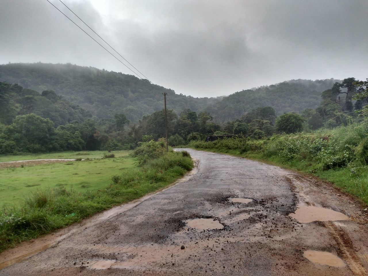 Nature Hills Coorg Road Potholes Rain
