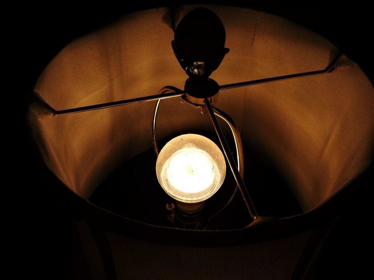 lighting equipment, illuminated, light bulb, electricity, glowing, electric lamp, indoors, no people, close-up, hanging, black background, lantern