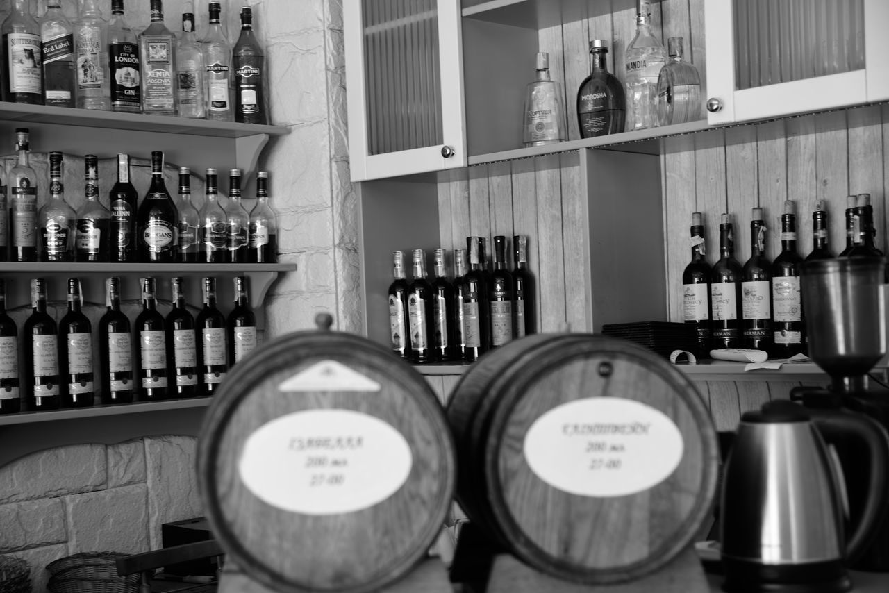 Georgian Food Georgian Resturant Food And Drink Shelf Indoors  Alcohol Food And Drink Industry Storephotography Lviv, Ukraine Black And White Photography Lviv Lvov Ukraine Street Photography NikonD810 Travel Destinations B&w Streetphotography Nikon D810 Focus On Foreground