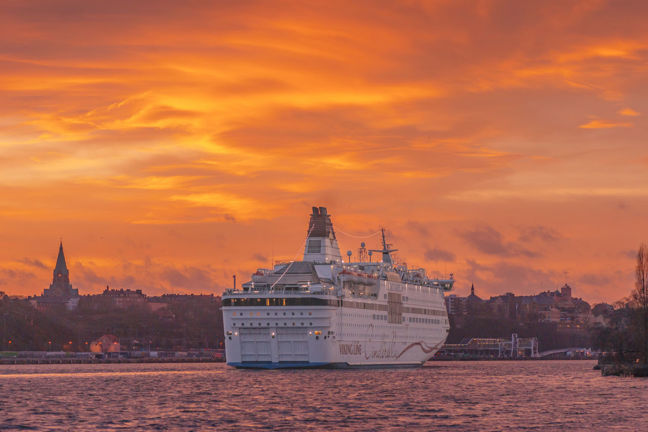 STOCKHOLM, SWEDEN - DEC 30, 2016: Cinderella from the Viking Line company embarking to the port in Stockholm. With a great orange evening sky. Archipelago Architecture Church Cinderella City Cityscape Cloud - Sky Nautical Vessel No People Outdoors Sailing Sea Ship Stockholm Sunset Sweet Urban Skyline Water