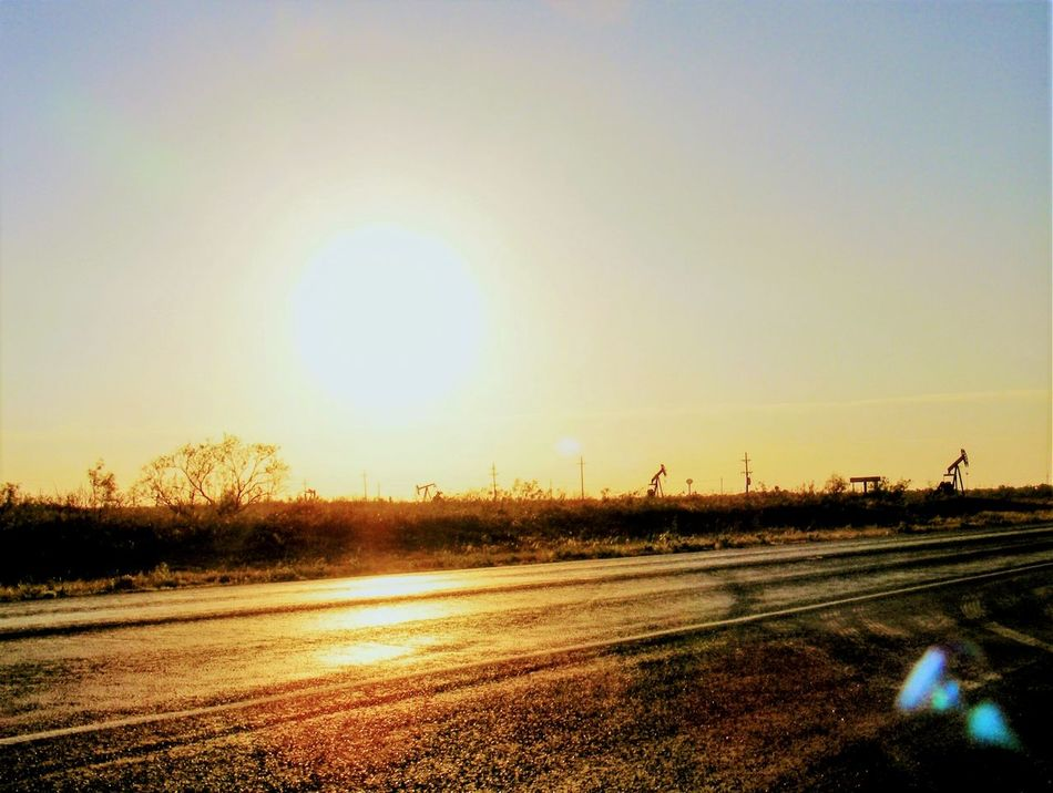Permian Basin Sunset Beauty In Nature Money Money Money No People Oil Fields Oilfield Permian Basin Pumpjack Road Sun Sunflare Sunlight Sunset Texas West Texas West Texas Landscape West Texas Sunset