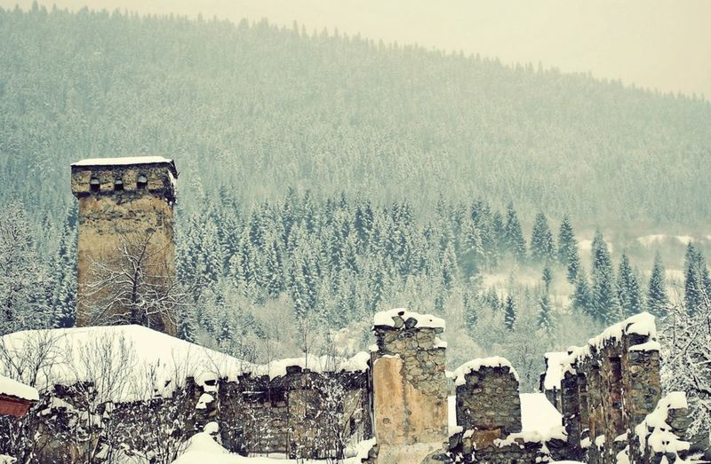 Beauty In Nature Cold Temperature Fog Foggy Landscape Mestia Nature Old Buildings Old Town Outdoors Scenics Sky Snow Svaneti Georgia Tranquility Winter