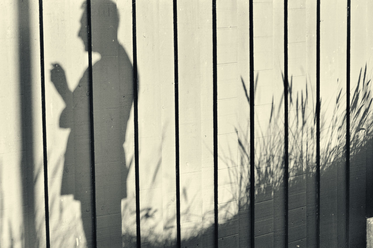Summerday memories. A Shadow Of One's Former Self Close-up Day Geradestehen Grass Keep Calm Man Nusshain 04 17 Outdoors Real People Schatten Fotografie Schatten Seiner Selbst Shadow Shadow Of A Man Take The Responsibility TCPM Vor Einer Wand Stehen Wall Wooden Fence Wooden Wall