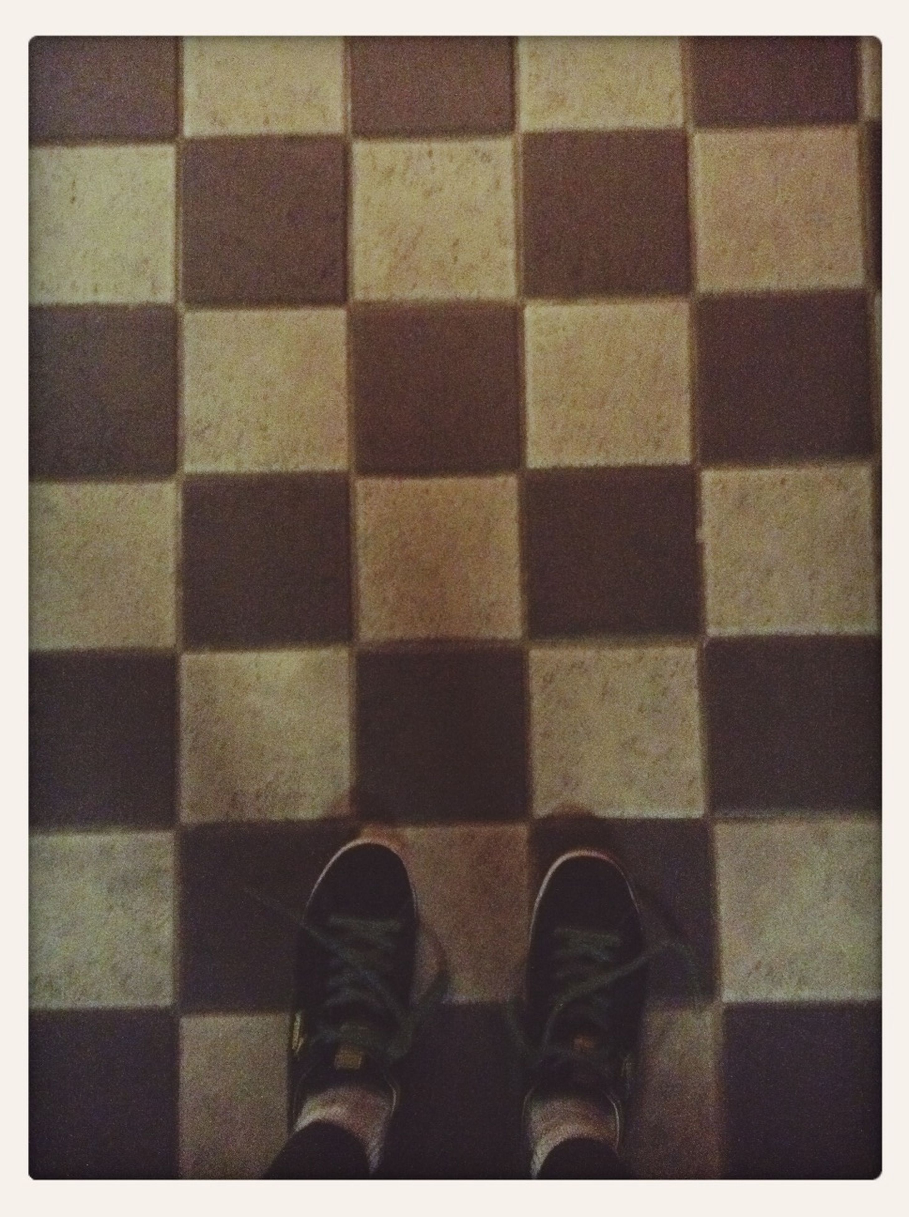 indoors, lifestyles, men, transfer print, auto post production filter, person, tiled floor, pattern, low section, standing, leisure activity, flooring, full frame, wall - building feature, unrecognizable person, tile