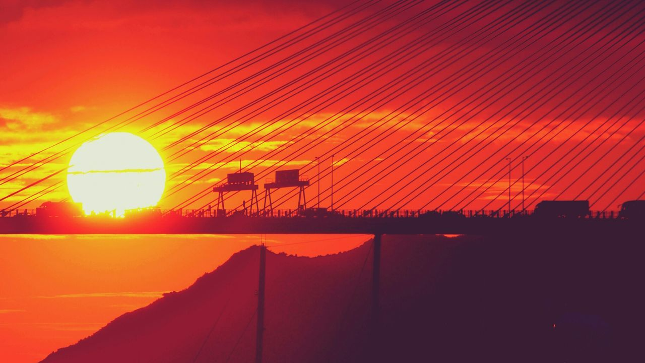 sunset, orange color, beauty in nature, nature, sun, sky, silhouette, outdoors, scenics, tranquil scene, no people, built structure, tranquility, technology, building exterior, architecture, day, astronomy