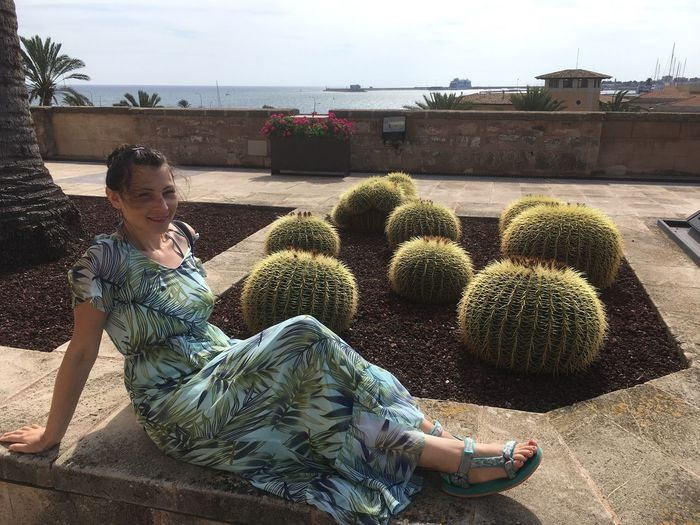Outdoors Building Exterior Full Length Growth Day Architecture One Person Plant Built Structure Sitting Real People Smiling Tree Retaining Wall Sky People Looking At Camera Beautiful Woman No Filter, No Edit, Just Photography Mallorca Second Acts