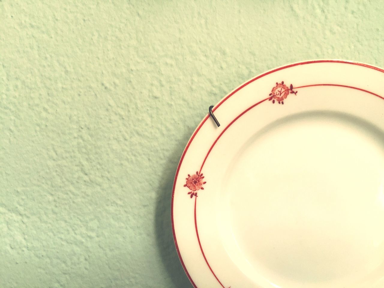 High Angle View Of Empty Plate On Wall