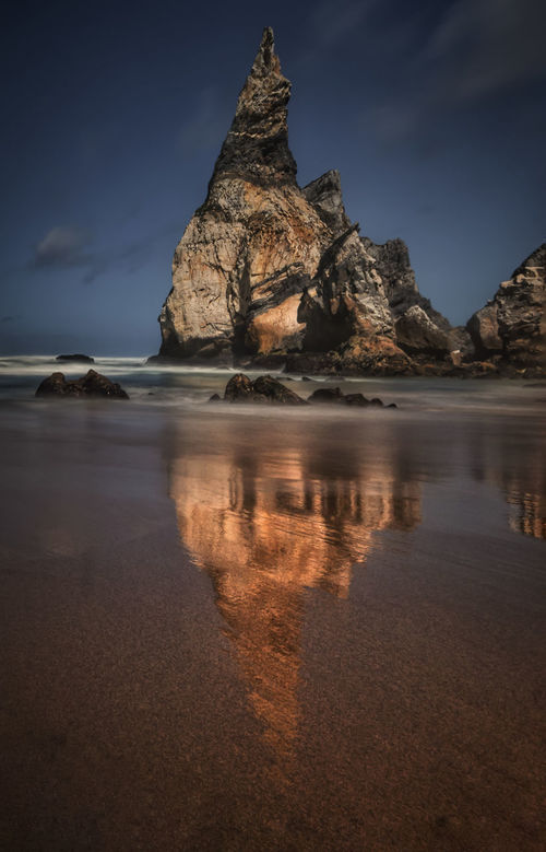 Reflection Travel Destinations Tourism Travel Water Outdoors Cloud - Sky Sky No People Popular Popular Photos Eye4photography  Nature Ursa Beach Beach Beachphotography Rock Formation Praia Da Ursa Sintra (Portugal) Beach Photography Sunset Sunset_collection Beach Day Paradise Beach Eye4photography