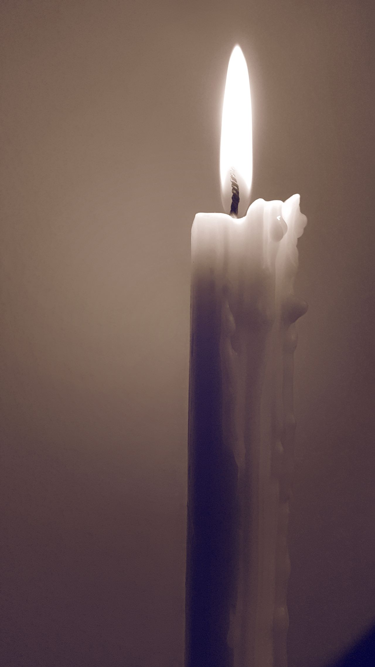 The light shines in the darkness, and the darkness has not overcome it Candlelight Flame Burning Candle Heat - Temperature No People Close-up Indoors  Wax Candle Fire Burning Light Up The Darkness Sepia Simplicity Monochrome_life Stillness In Time Still Life Lux Sepia Scenes White