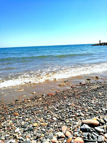 Sun Beach Stones Water Sand & Sea One Man Only Blue Sea Man Fishing Rocks EyeEmNewHere