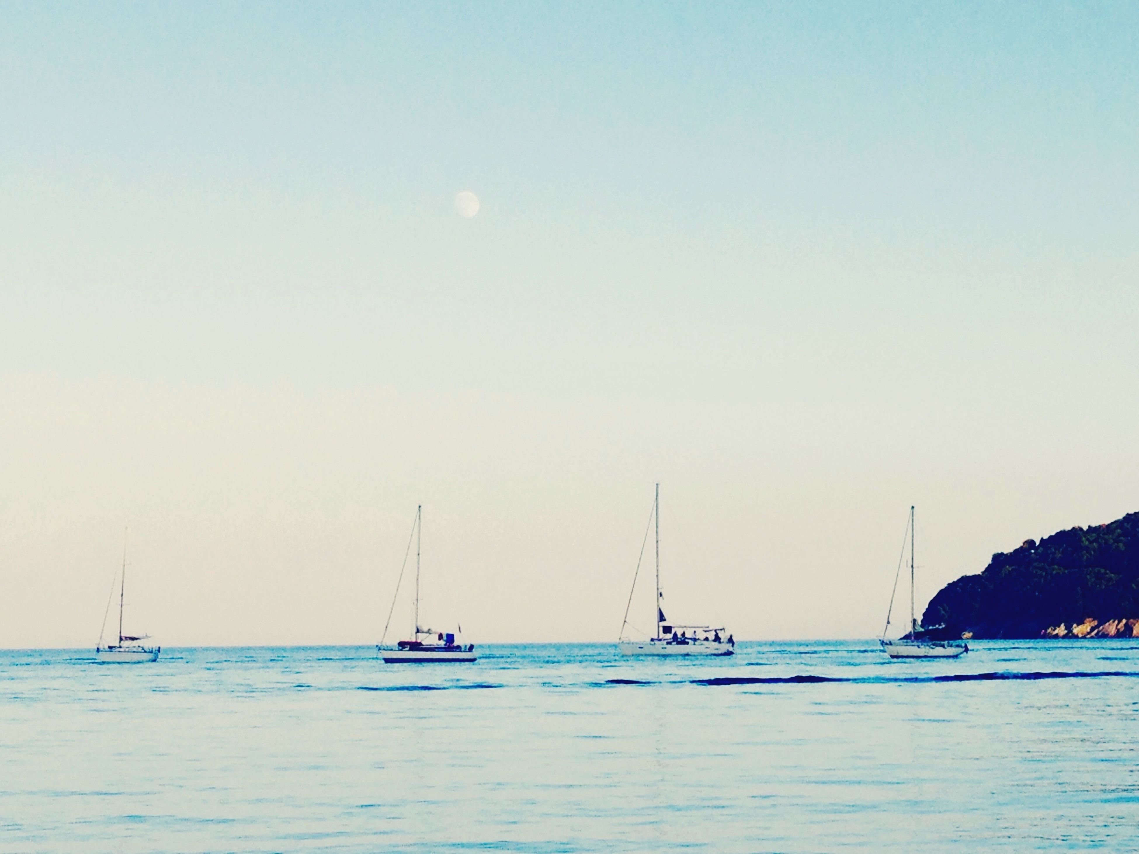 sea, nautical vessel, water, transportation, boat, mode of transport, waterfront, clear sky, copy space, horizon over water, tranquil scene, tranquility, scenics, sailboat, beauty in nature, nature, blue, moored, travel, beach