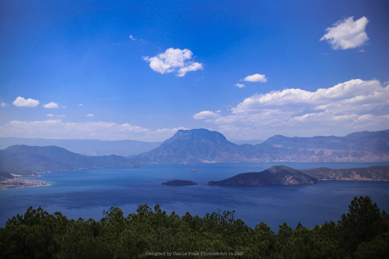 mountain, beauty in nature, tranquil scene, tranquility, nature, scenics, sky, blue, mountain range, outdoors, cloud - sky, no people, day, water, landscape, tree