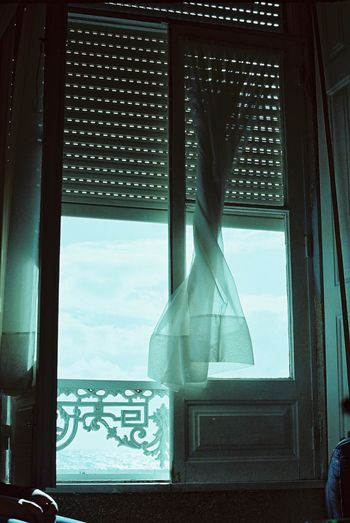 1979 Blue Curtain Day Drapes  Glass Glass - Material Indoors  No People Resort Sky Transparent Window Window Frame