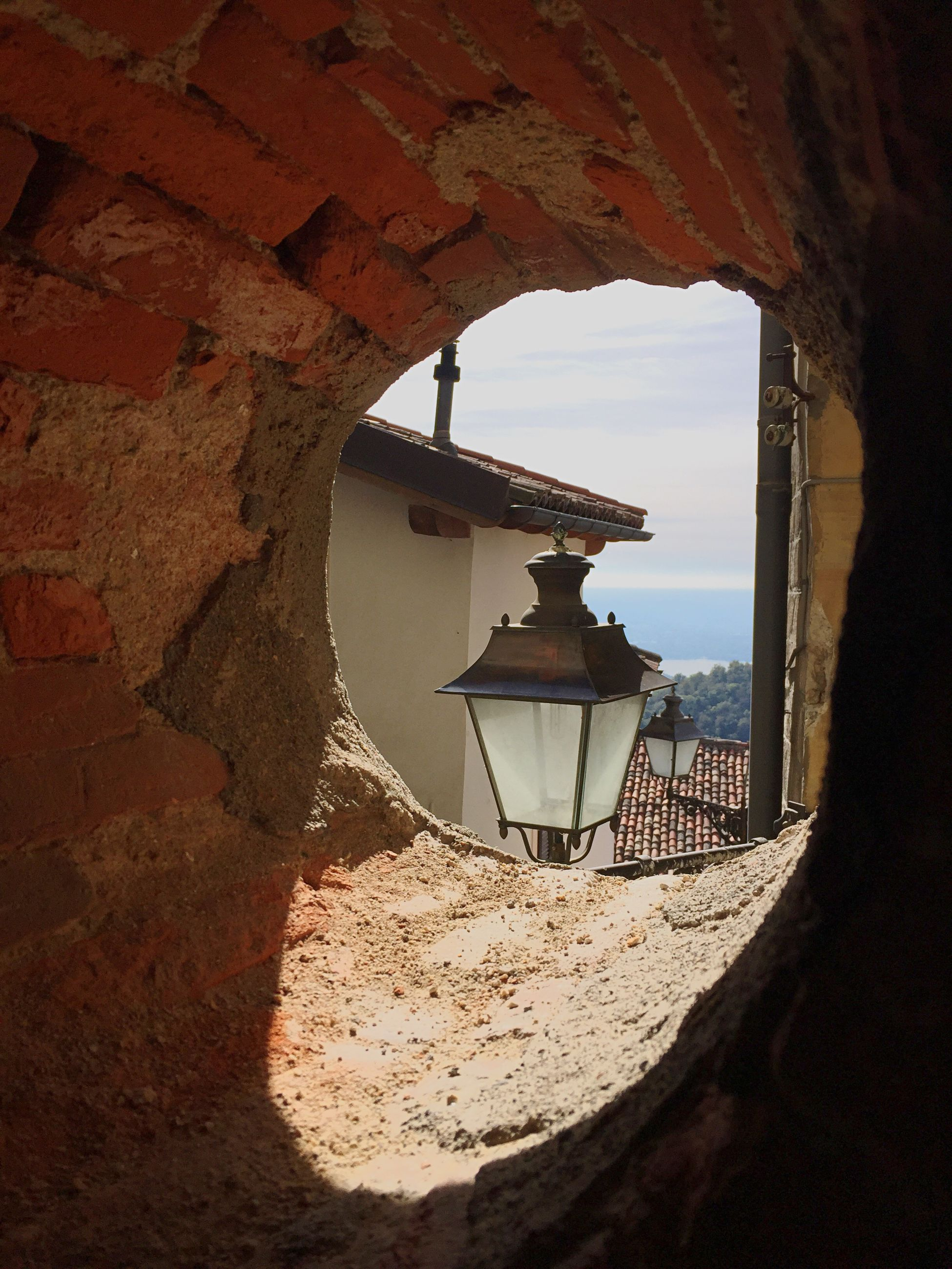 wall - building feature, built structure, architecture, indoors, hole, window, sea, sky, day, stone material, town, no people, weathered