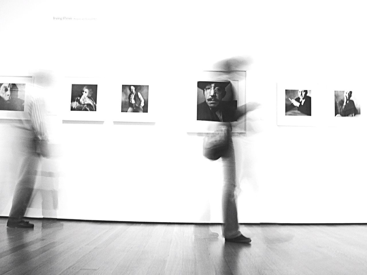 The pictures remain... Bnw_friday_eyeemchallenge Museum Time Blackandwhite Motion Bnw_collection Gallery Exhibition Full Length Men Women People Adult Young Adult White Background Indoors  Adults Only One Person