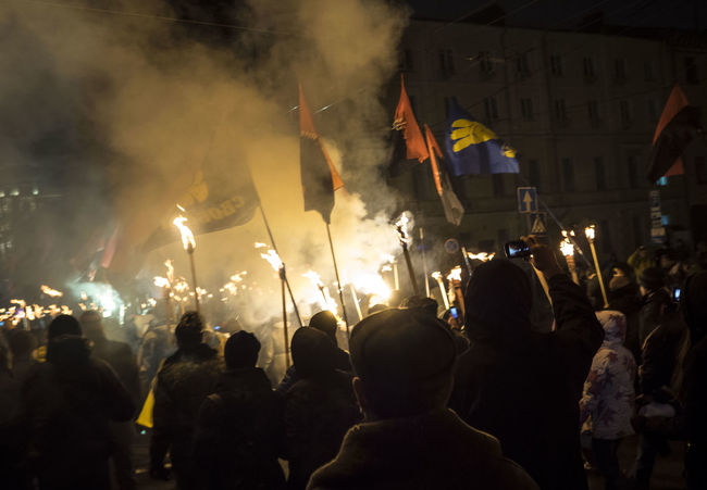 The torchlight procession in honor of the birthday of Stepan Bandera, national hero of Ukraine Bandera Birthday Building Exterior Built Structure Celebration Crowd Cultures HERO Illuminated Large Group Of People Men National Night People And Places Person Procession Road Smoke - Physical Structure Stepan Street Togetherness Torchlight Tradition Ukrain Ukraine