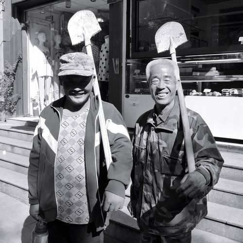 Real People Two People Traditional Clothing Cultures Men Outdoors Tradition Day Togetherness Building Exterior Architecture Only Men Adult Adults Only People Worker On Chinese Streets China Photos On The Streets The Street Photographer - 2017 EyeEm Awards The Photojournalist - 2017 EyeEm Awards Chinese Street Workers Construction Work In China China Photos China.