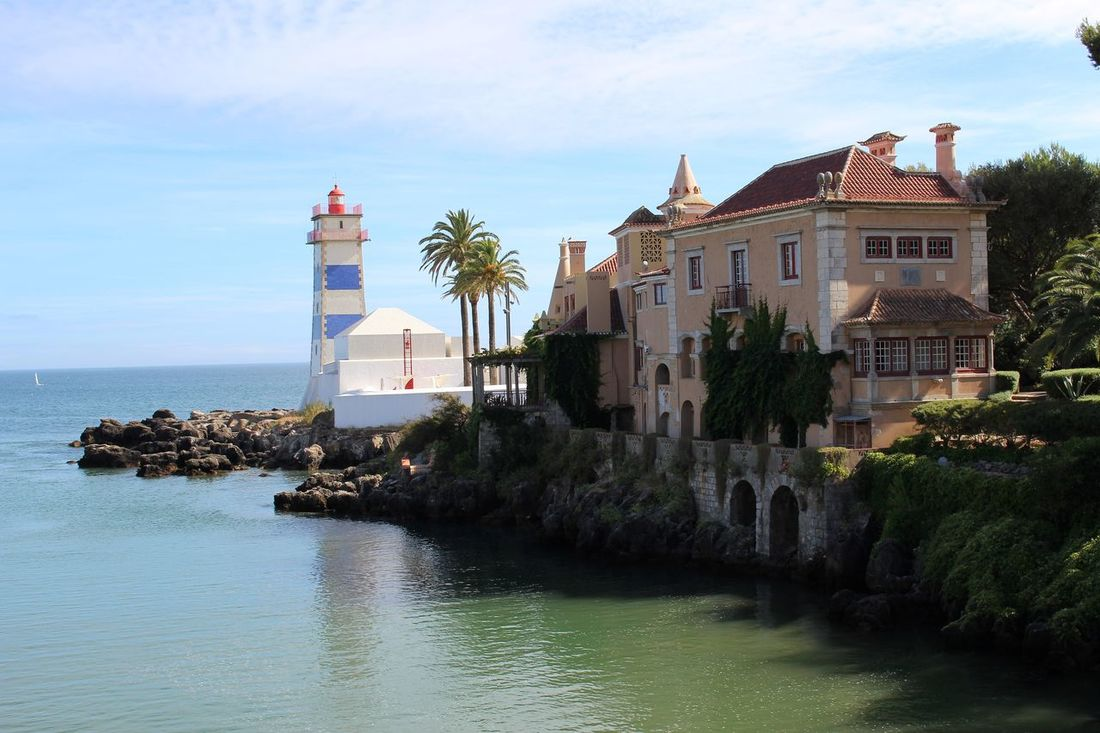 Repost but this time in Color. Old House Lighthouse Seaside Sky And Clouds Rocks And Water Arquitecture Eyeemphotography Eye4photography  EyeEmBestPics EyeEm Best Shots Urban Geometry Urban Landscape EyeEm Taking Photos in Cascais Portugal Showcase: November Seeing The Sights My Best Photo 2015