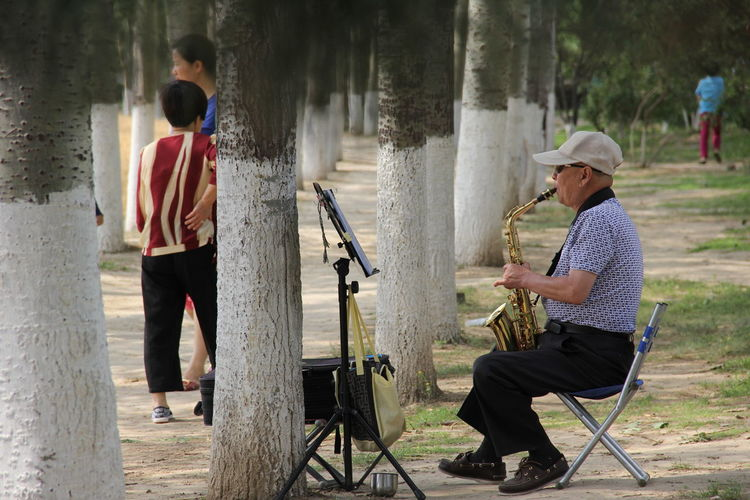 Two People Playing WoodLand Saxophone Saxophone Player