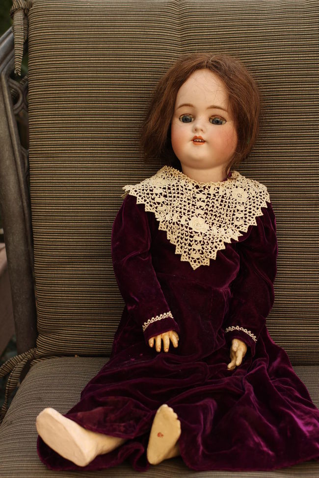 antiqur dollwith red hair and purple velvet dress Antique Antique Doll Bisque Casual Clothing Comfortable Day Lace Lace Collar Leaning Leisure Activity Lifestyles Lying Down Portrait Redhead Relaxation Resting Sitting Sofa Velvet Velvet Dress