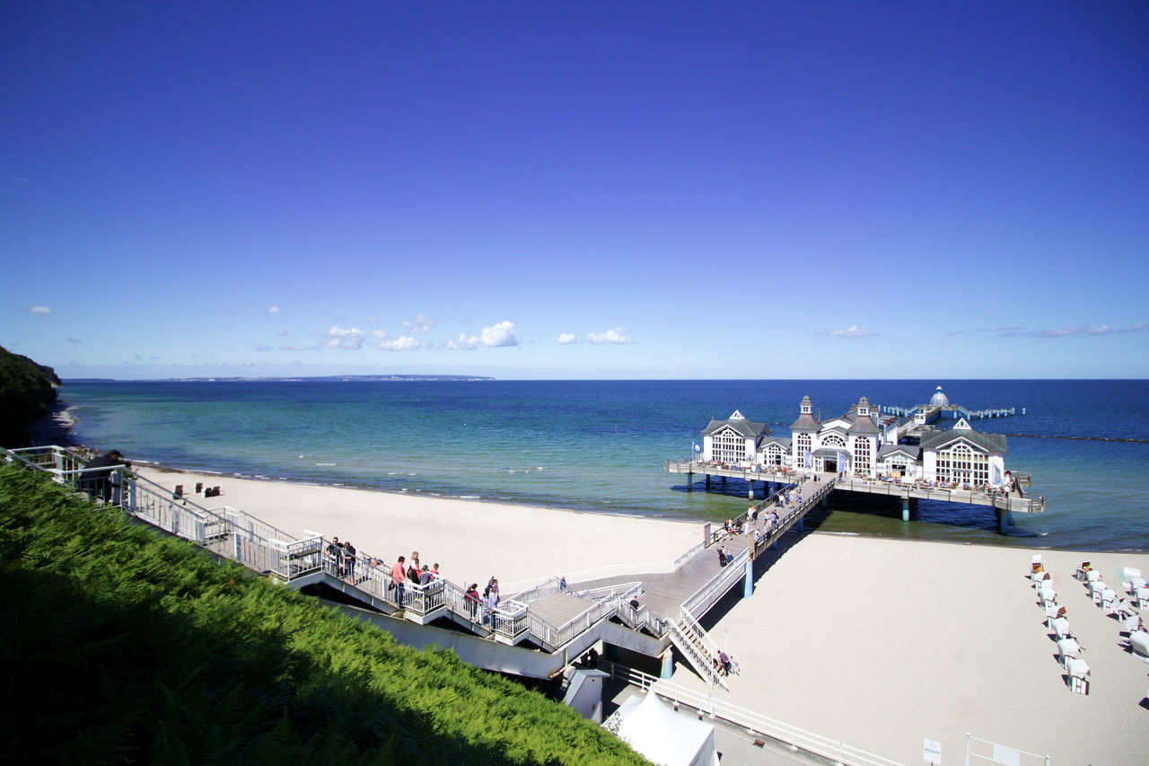 Rügen Rügen Lovers Architecture Beach Beauty In Nature Blue Building Exterior Built Structure Clear Sky Cruise Ship Day High Angle View Horizon Over Water Large Group Of People Nature Nautical Vessel Outdoors People Real People Scenics Sea Sky Transportation Vacations Water