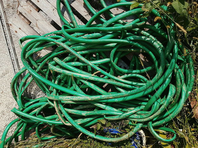 snake pit sunday Green Color Strength Close-up Sunlight Twisted Nature Day The Past Outdoors Complexity Intricacy Full Frame No People Weathered Creativity Snake Snakepit Hose Green Tangled Snake Pit Watering Minimal Minimalism Abstract